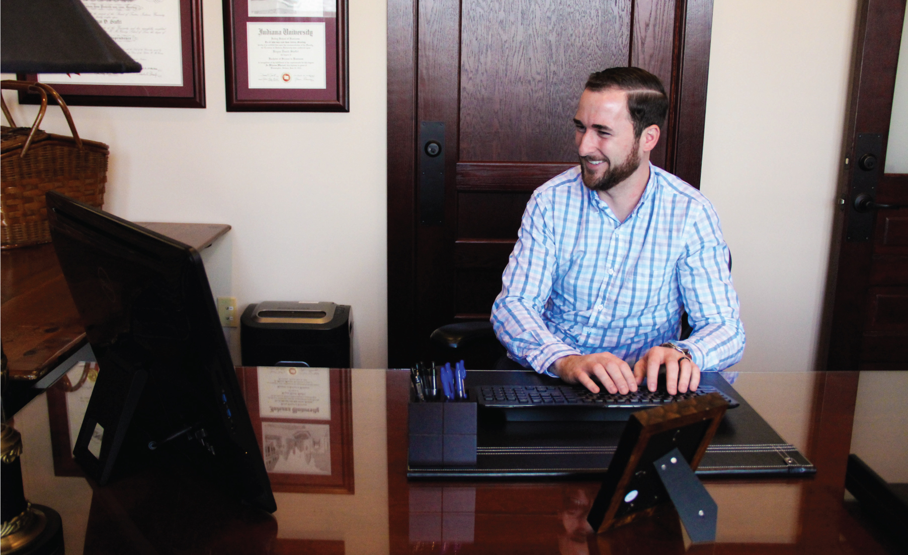 Indianapolis Adoption Lawyer Bryan D. Stoffel typing on computer