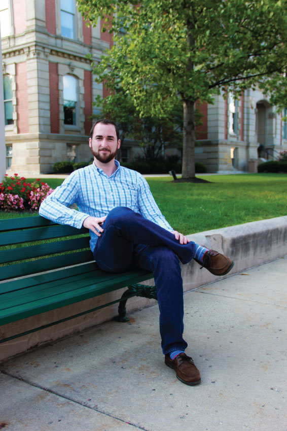 Indianapolis Adoption Lawyer Bryan D. Stoffel sitting on park bench in Indianapolis