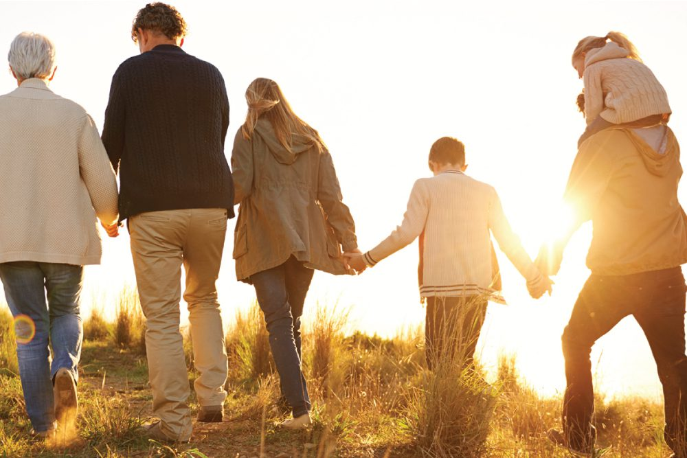 family holding hand and walking together after visiting Indianapolis Family Law Lawyer Bryan D. Stoffel